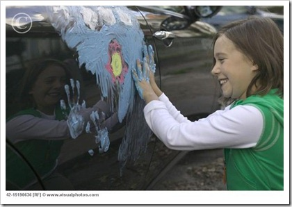 laughing_girl_painting_car_with_finger_paint_42-15190636